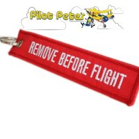 """Remove before flight"" Key ring / alert banner"